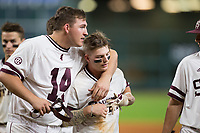 Hunter Stovall (right) gets a hug from teammate Riley Self (14) following his walk-off sacrifice fly in the bottom of the 12th inning against the Houston Cougars in game six of the 2018 Shriners Hospitals for Children College Classic at Minute Maid Park on March 3, 2018 in Houston, Texas. The Bulldogs defeated the Cougars 3-2 in 12 innings. (Brian Westerholt/Four Seam Images)
