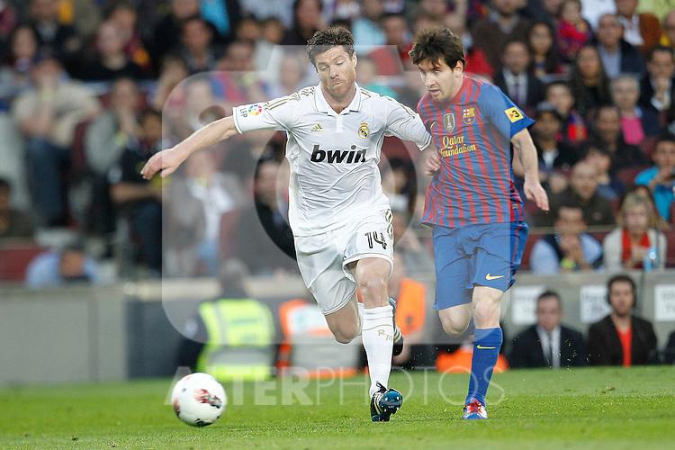Barcelona's Lionel Messi and Real Madrid's Xabi Alonso during la liga match on april 21st 2012...Photo: Cesar Cebolla / ALFAQUI