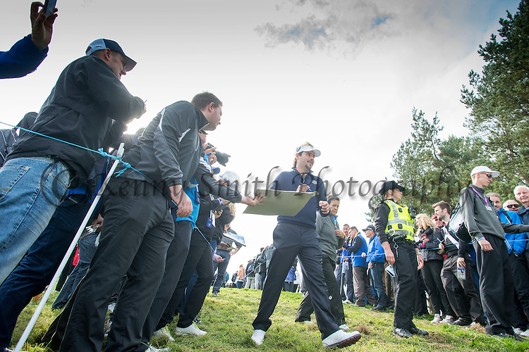 Frenchman Victor Dubisson signs autographs as he makes his way to the 8th tee during a practice session at Gleneagles Golf Course, Perthshire. Photo credit should read: Kenny Smith/Press Association Images.