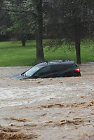 Flood water swirls around a vehicle Wednesday April 28 2021 on Dream Valley Road on the east edge of Rogers, about 100 yards south of Arkansas 12. Go to nwaonline.com/210429Daily/ to see more photos.<br />