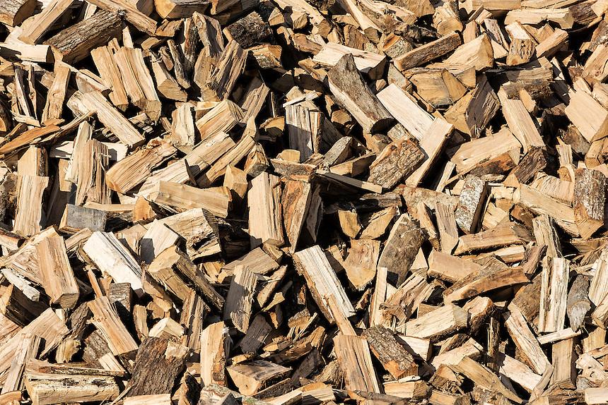 Large stack of split firewood