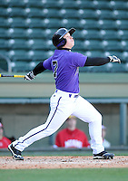 Third baseman Chris Ohmstede (7) of the Furman Paladins hits in a game against the Miami (Ohio) Redhawks on Sunday, February 17, 2013, at Fluor Field at the West End in Greenville, South Carolina. Furman won, 6-5. (Tom Priddy/Four Seam Images)