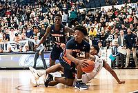 WASHINGTON, DC - NOVEMBER 16: Sherwyn Devonish #5 of Morgan State retrieves a loose ball during a game between Morgan State University and George Washington University at The Smith Center on November 16, 2019 in Washington, DC.