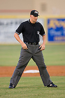 Umpire Brandon Henson handles the calls on the bases during a Florida State League game between the Charlotte Stone Crabs and the Jupiter Hammerheads at Roger Dean Stadium June 15, 2010, in Jupiter, Florida.  Photo by Brian Westerholt /  Seam Images
