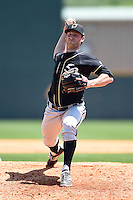 Omaha Storm Chasers pitcher Spencer Patton (32) delivers a pitch during a game against the Nashville Sounds on May 20, 2014 at Herschel Greer Stadium in Nashville, Tennessee.  Omaha defeated Nashville 4-1.  (Mike Janes/Four Seam Images)