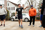 December 22, 2014. Lexington, North Carolina.<br />  Mayor Newell Clark, center, asks each participant how many reps they plan on doing for the day during their workout.<br />   Newell Clark, the 43 year old mayor of Lexington, NC, leads a group of friends and colleagues on a 4 times a week exercise routine around downtown. The group uses existing infrastructure, such as an abandoned furniture factory, loading docks, stairs, and handrails to get fit and increase awareness of healthy lifestyles in a town more known for BBQ.<br /> Jeremy M. Lange for the Wall Street Journal<br /> Workout_Clark