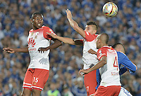 BOGOTA - COLOMBIA -20 -03-2016: Michael Rangel (Der) jugador de Millonarios disputa el balón con Hector Urrego (Izq), Juan D Roa (C) y Sergio Otalvaro (C Der) jugadores de Independiente Santa Fe durante por la fecha 10 de la Liga Águila I 2016 jugado en el estadio Nemesio Camacho El Campín de la ciudad de Bogotá./ Michael Rangel (R) player of Millonarios fights for the ball with Hector Urrego (L), Juan D Roa (C) and Sergio Otalvaro (C R) player of Independiente Santa Fe during the match for the date 10 of the Aguila League I 2016 played at Nemesio Camacho El Campin stadium in Bogota city. Photo: VizzorImage / Gabriel Aponte / Staff.