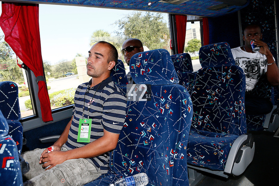 20 September 2012: Thomas Meley, Rene Leveret and Sneideer Santo listen to Team France manager Jim Stoeckel in the bus prior to Spain 8-0 win over France, at the 2012 World Baseball Classic Qualifier round, in Jupiter, Florida, USA.