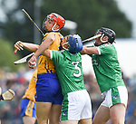 Peter Duggan of Clare in action against Mike Casey and Darragh O Donovan of Limerick during their Munster championship game in Ennis. Photograph by John Kelly.