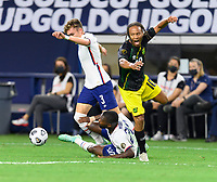 DALLAS, TX - JULY 25: Sam Vines #3 and Shaq Moore #20 of the United States chase after a loose ball in front of Bobby Reid #10 of Jamaica during a game between Jamaica and USMNT at AT&T Stadium on July 25, 2021 in Dallas, Texas.