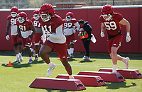 Mataio Soli (11) participates in an agility drill during the University of Arkansas Razorback Spring football practice Thursday, April 1, 2021, at the University practice field on the campus in Fayetteville. Check out nwaonline.com/210402Daily/ and nwadg.com/photos for a photo gallery.<br /> (NWA Democrat-Gazette/David Gottschalk)