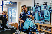 Paul Hayes of Wycombe Wanderers serves in the club shop during the 2016/17 Kit Launch of Wycombe Wanderers to the public at Adams Park, High Wycombe, England on 10 July 2016. Photo by David Horn.