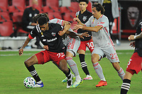 WASHINGTON, DC - SEPTEMBER 12: Donovan Pines #23 of D.C. United battles for the ball with Brian White #42 and Florian Valot #22 of New York Red Bulls during a game between New York Red Bulls and D.C. United at Audi Field on September 12, 2020 in Washington, DC.
