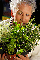 Older female person with herbs
