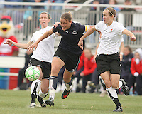 Abby Wambach (blue) of the Washington Freedom battles Keely Dowling and Jen Buczkowski  of Sky Blue F.C. during a WPS pre season match at Maryland Soccerplex,in Boyd's, Maryland on March 14 2009. Sky Blue won the match 1-0