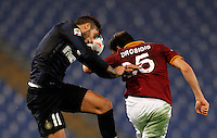 Calcio, Serie A: Roma vs Inter. Roma, stadio Olimpico, 1 marzo 2014.<br /> FC Inter midfielder Gabriel Alvarez, of Argentina, and AS Roma defender Vasilis Torosidis, of Greece, jump for the ball during the Italian Serie A football match between AS Roma and FC Inter at Rome's Olympic stadium, 1 March 2014.<br /> UPDATE IMAGES PRESS/Riccardo De Luca