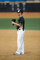 Wake Forest Demon Deacons first baseman Gavin Sheets (24) on defense against the Miami Hurricanes at Wake Forest Baseball Park on March 22, 2015 in Winston-Salem, North Carolina.  The Demon Deacons defeated the Hurricanes 10-4.  (Brian Westerholt/Four Seam Images)