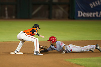 AZL Reds right fielder Reniel Ozuna (29) slides around the tag of Francisco Medina at second base during the game against the AZL Giants on August 12, 2017 at Scottsdale Stadium in Scottsdale, Arizona. AZL Giants defeated the AZL Reds 1-0. (Zachary Lucy/Four Seam Images)
