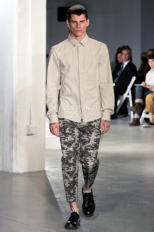 Model walks runway in an outfit by Aharon Kolatch, for the 2012 Pratt Institute fashion show, at Center548 NYC, on April 26, 2012.
