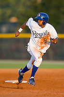 Luis Piterson #8 of the Burlington Royals watches the baseball as he takes off for third base against the Greeneville Astros at Burlington Athletic Stadium June22, 2010, in Burlington, North Carolina.  Photo by Brian Westerholt / Four Seam Images