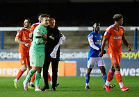 Blackpool's Chris Maxwell with Blackpool manager Neil Critchley at the end of the game<br /> <br /> Photographer Chris Vaughan/CameraSport<br /> <br /> The EFL Sky Bet League One - Peterborough United v Blackpool - Saturday 21st November 2020 - London Road Stadium - Peterborough<br /> <br /> World Copyright © 2020 CameraSport. All rights reserved. 43 Linden Ave. Countesthorpe. Leicester. England. LE8 5PG - Tel: +44 (0) 116 277 4147 - admin@camerasport.com - www.camerasport.com