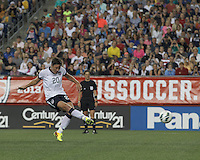 USWNT substitute forward Abby Wambach (20) scores on penalty kick. In an international friendly, the U.S. Women's National Team (USWNT) (white/blue) defeated Korea Republic (South Korea) (red/blue), 4-1, at Gillette Stadium on June 15, 2013.