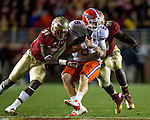 "FSU defensive back Terrence Brooks (31) and defensive end Cornellius ""Tank"" Carradine (91) converge on UF quarterback Jeff Driskel for a sack. The 6th ranked University of Florida Gators defeated the 10th ranked Florida State Seminoles 37-26 at Doak S. Campbell Stadium in Tallahassee, Florida Nov. 24, 2012."