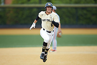 Michael Turconi (6) of the Wake Forest Demon Deacons legs out a triple leading off the bottom of the first inning against the Miami Hurricanes at David F. Couch Ballpark on May 11, 2019 in  Winston-Salem, North Carolina. The Hurricanes defeated the Demon Deacons 8-4. (Brian Westerholt/Four Seam Images)