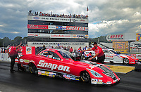 Aug. 21, 2011; Brainerd, MN, USA: NHRA  crew members for funny car driver Cruz Pedregon during the Lucas Oil Nationals at Brainerd International Raceway. Mandatory Credit: Mark J. Rebilas-