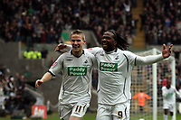 Pictured: Jason Scotland of Swansea (R) is celebrating his equalizer with team mate Mark Gower (L)<br />