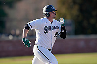 Brady Garrison (30) of the University of South Carolina Upstate Spartans runs out a batted ball in a game against the University of Toledo Rockets on Friday, February 19, 2021, at Cleveland S. Harley Park in Spartanburg, South Carolina. Upstate won, 14-2. (Tom Priddy/Four Seam Images)