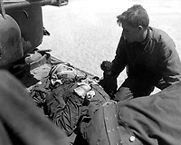 Crew members of Co. D, 89th Tank Bn., give first aid to wounded soldier, during action against the Chinese Communist forces north east of Seoul, Korea.  May 1, 1951.  Pfc. Charles Fabiszak. (Army)<br /> NARA FILE #  III-SC-366309<br /> WAR & CONFLICT BOOK #:  1452