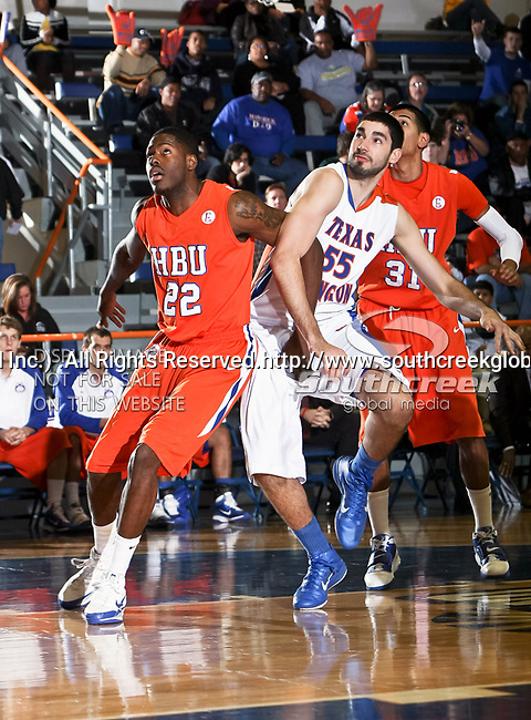 Houston Baptist Huskies forward Sammy Obetoh (22) blocks out Texas-Arlington Mavericks forward Jordan Reves (55) after a free throw in the game between the UTA Mavericks and the Houston Baptist Huskies held at the University of Texas in Arlington's Texas Hall in Arlington, Texas. UTA defeats Houston Baptist 72 to 57