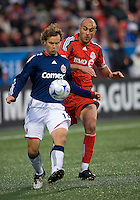 22 April 2009: Chivas USA defender Carey Talley #12 and Toronto FC forward Danny Dichio #9 in action at BMO Field in Toronto in a MLS game between Chivas USA and Toronto FC..Toronto FC won 1-0.