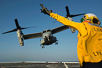 130423-N-DR144-866 Pacific Ocean (April 23, 2013)- Aviation Boatswain's Mate (Handling) Airman Katie Glendy, assigned to Amphibious Transport Dock Ship USS San Diego (LPD 22), directs the launch of an MV-22 Osprey assigned to Marine Medium Tiltrotor Squadron (VMM) 161 on the flight deck of the Amphibious Transport Dock Ship USS Anchorage (LPD 23). Air Department Sailors from San Diego are aboard Anchorage earning qualifications and maintaining proficiency while the ship is underway. Anchorage is currently en route to its namesake city of Anchorage, Alaska for its commissioning ceremony May 4. (U.S. Navy photo by Mass Communication Specialist 1st Class James R. Evans / RELEASED)