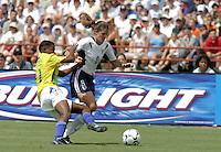 Mia Hamm v Formiga of Brazil at Tad Gormley Stadium Sunday 7/13/03 in New Orleans.Photo by: J. Brett Whitesell/ISI