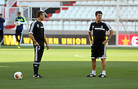 Valencia, Spain. Wednesday 18 September 2013<br /> Pictured L-R: Swansea scout Erik Larsen and manager Michael Laudrup.<br /> Re: Swansea City FC training ahead of their UEFA Europa League game against Valencia C.F. at the Estadio Mestalla, Spain,