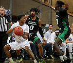 SIOUX FALLS, SD - MARCH 7: Max Abmas #3 of the Oral Roberts Golden Eagles looks for help out of a double team by Caleb Nero #0 and Bentiu Panoam #11 of the North Dakota Fighting Hawks during the Summit League Basketball Tournament at the Sanford Pentagon in Sioux Falls, SD. (Photo by Dave Eggen/Inertia)