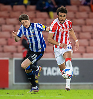 16th February 2021; Bet365 Stadium, Stoke, Staffordshire, England; English Football League Championship Football, Stoke City versus Sheffield Wednesday; Jacob Brown of Stoke City is chased down by Adam Reach of Sheffield Wednesday