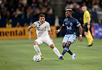 CARSON, CA - MARCH 07: Cristian Dajome #11 of the Vancouver Whitecaps passes off the ball during a game between Vancouver Whitecaps and Los Angeles Galaxy at Dignity Health Sports Park on March 07, 2020 in Carson, California.