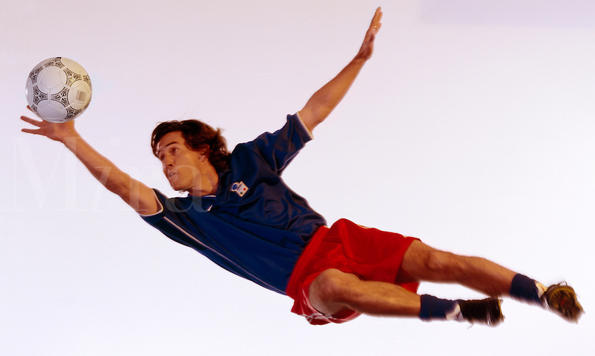 Soccer goalie making a save.
