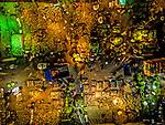 Bangladesh night market glows as people pack into narrow streets by Rakibul alam Khan
