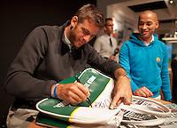 11-02-14, Netherlands,Rotterdam,Ahoy, ABNAMROWTT,Juan-Martin Del Potro signing autographs<br /> Photo:Tennisimages/Henk Koster