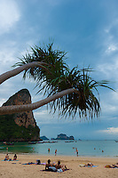 Tourists sunbathing on Railay beach, Krabi