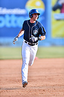 Asheville Tourists left fielder Vince Fernandez (8) rounds the bases during a game against the Lakewood BlueClaws at McCormick Field on June 3, 2017 in Asheville, North Carolina. The Tourists defeated the BlueClaws 10-7. (Tony Farlow/Four Seam Images)