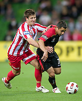 MELBOURNE, AUSTRALIA - NOVEMBER 19: Michael Marrone of the Heart and Lucas Pantelis of Adelaide compete for the ball during the round 15 A-League match between the Melbourne Heart and Adelaide United at AAMI Park on November 19, 2010 in Melbourne, Australia (Photo by Sydney Low / Asterisk Images)