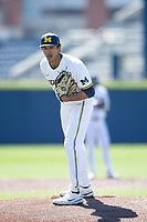 Michigan Wolverines pitcher Isaiah Paige (25) looks to his catcher for the sign during the NCAA baseball game against the Illinois Fighting Illini on March 20, 2021 at Fisher Stadium in Ann Arbor, Michigan. Michigan won the game 8-1. (Andrew Woolley/Four Seam Images)