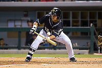 Carlos Sanchez (13) of the Charlotte Knights attempts to lay down a bunt against the Pawtucket Red Sox at BB&T Ballpark on August 9, 2014 in Charlotte, North Carolina.  The Red Sox defeated the Knights  5-2.  (Brian Westerholt/Four Seam Images)