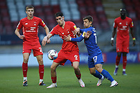 Conor Wilkinson of Leyton Orient and Lloyd Kerry of Harrogate Town during Leyton Orient vs Harrogate Town, Sky Bet EFL League 2 Football at The Breyer Group Stadium on 21st November 2020
