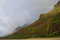 Kalalau Beach with a rainbow and Na Pali coastline, Kaua'i.